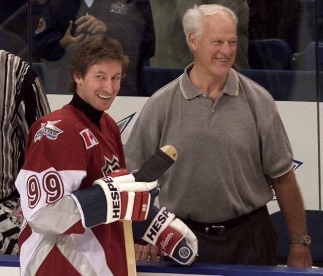 Hockey superstar Wayne Gretzky, left, of the New York Rangers, shares a laugh hockey legend and childhood hero Gordie Howe during All-Star practice at the Ice Palace in Tampa, Florida, Jan. 23, 19 ...
