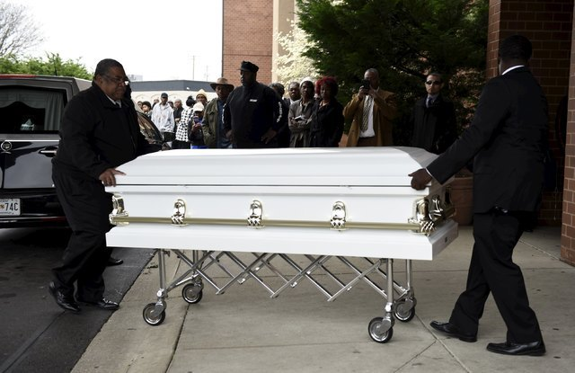 The casket of Freddie Gray, 25, a Baltimore black man who died in police custody, arrives at New Shiloh Baptist Church in Baltimore April 27, 2015. (Sait Serkan Gurbuz/Reuters)