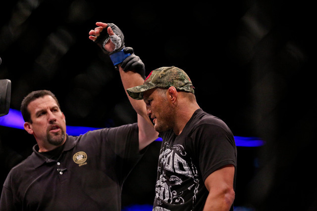 John McCarthy raises the arm of Dan Henderson, who defeated Tim Boetsch during UFC Fight Night at the Smoothie King Center in New Orleans, La., on June 6, 2015. (Derick E. Hingle/USA Today Sports)