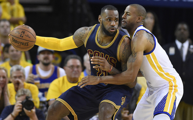 Cleveland Cavaliers forward LeBron James (23) drives to the basket against Golden State Warriors guard Andre Iguodala (9) during the fourth quarter in game five of the 2015 NBA Finals at Oracle Ar ...