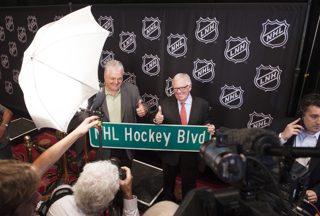 Clark County Commissioner Steve Sisolak, left, and team owner Bill Foley pose with a mock street sign following a National Hockey League (NHL) news conference held at the Encore at Wynn Las Vegas  ...