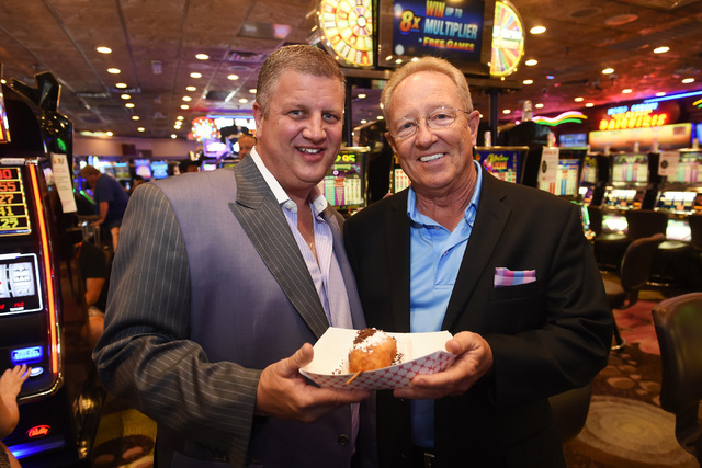 Co-owner and CEO of Desert Rock Enterprises, which includes the D Las Vegas and Golden Gate Hotel & Casino, Derrick Stevens his COO Dave Tuttle hold one of Mermaids Casino's signature deep-fri ...