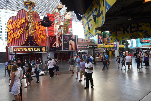 Pedestrians walk down the Fremont Street Experience Saturday, June 25, 2016. Mermaids Casino, La Bayou and Glitter Gulch will close their doors on June 27th to make way for a new project. (Sam Mor ...