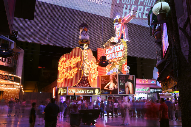 The Girls of Glitter Gulch strip club is seen at the Fremont Street Experience Saturday, June 25, 2016. Mermaids Casino, La Bayou and Glitter Gulch will close their doors on June 27th to make way  ...