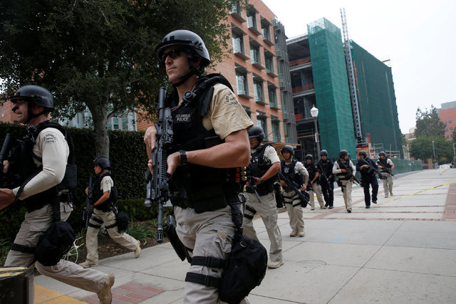 A Los Angeles Metro Police squad conducts a search on the UCLA campus after it was placed on lockdown. (Patrick T. Fallon/Reuters)