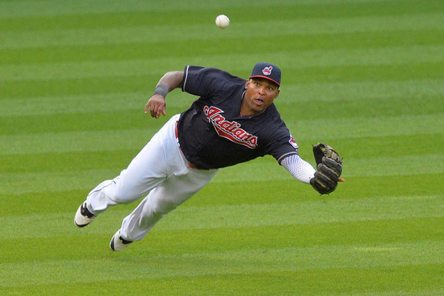 May 31, 2016; Cleveland, OH, USA; Cleveland Indians left fielder Marlon Byrd (6) dives for a base hit by Texas Rangers second baseman Jurickson Profar (not pictured) in the eighth inning at Progre ...