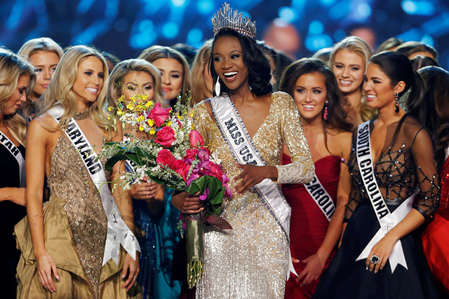 Deshauna Barber, center, of the District of Columbia, celebrates with other contestants after being crowned Miss USA 2016 during the 2016 Miss USA pageant at the T-Mobile Arena in Las Vegas, June  ...