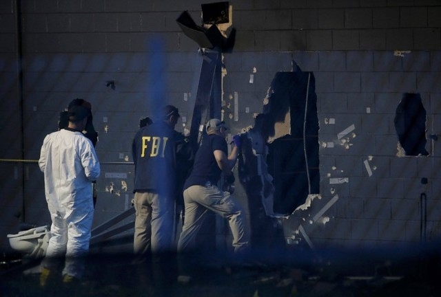Police forensic investigators work at the crime scene of a mass shooting at the Pulse gay night club in Orlando, Florida, U.S. June 12, 2016.   (Jim Young/Reuters)