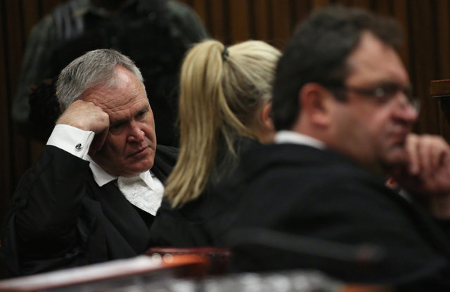 Barry Roux (L) , defense lawyer for Paralympic gold medalist Oscar Pistorius gestures during the third day of his clients resentencing hearing for the 2013 murder of his girlfriend Reeva Steenkamp ...