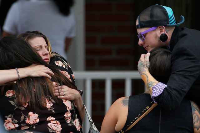 Mourners hug before the funeral for Kimberly Morris, one of the victims of the shooting at the Pulse night club in Orlando, in Kissimmee, Florida, U.S., June 16, 2016.  (Carlo Allegr/Reuters)