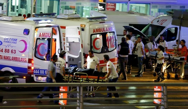 Paramedics push a stretcher at Turkey's largest airport, Istanbul Ataturk, Turkey, following a blast June 28, 2016. (Osman Orsal/Reuters)