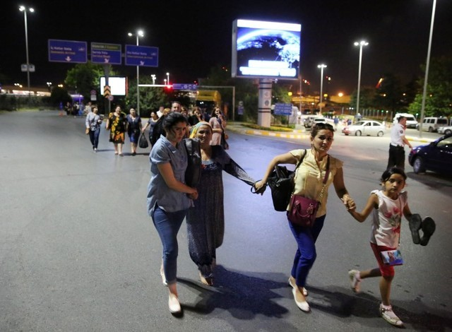 People walk away from Istanbul Ataturk airport, Turkey, following a blast June 28, 2016. (Goran Tomasevic/Reuters)