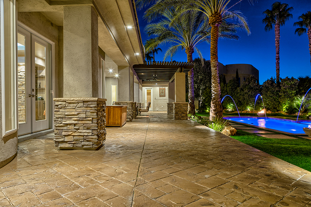 The Grand Legacy home features a resort-style backyard. (COURTESY OF LUXURY ESTATES INTERNATIONAL)