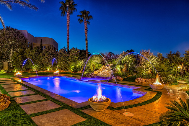 The pool and spa area features colored lights. (COURTESY OF LUXURY ESTATES INTERNATIONAL)