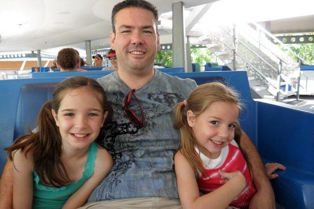 From left, Alexis, Michael and Emma Reed smile for a photo while on a tram ride at Disney World in Orlando, Fla., in July 2009. Michael has been a stay-at-home-dad for almost eight years. Special  ...