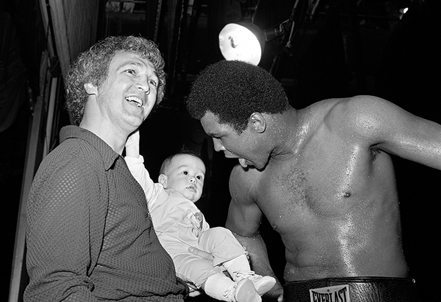 Muhammad Ali jokes with a baby during a work out for his fight against Ron Lyle May 12, 1975 at the Tropicana in Las Vegas. (Las Vegas News Bureau)