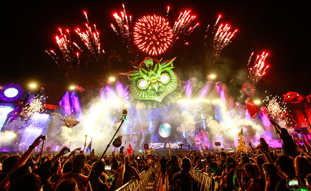 Attendees watch the opening ceremony performance at the Kinetic Field stage at Electric Daisy Carnival at the Las Vegas Motor Speedway in Las Vegas on Saturday, June 20, 2015. (Chase Stevens/Las V ...