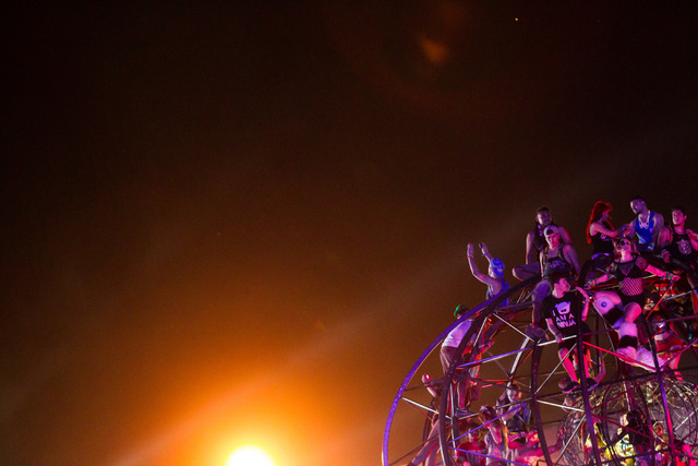 Attendees take in the views from the top of the ePod art installation at Electric Daisy Carnival at the Las Vegas Motor Speedway in Las Vegas during the early hours of Monday, June 22, 2015. (Chas ...