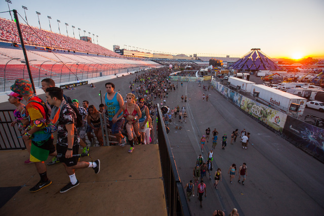 Attendees leave the festival grounds as the sun rises at Electric Daisy Carnival at the Las Vegas Motor Speedway in Las Vegas on Monday, June 22, 2015. (Chase Stevens/Las Vegas Review-Journal) Fol ...