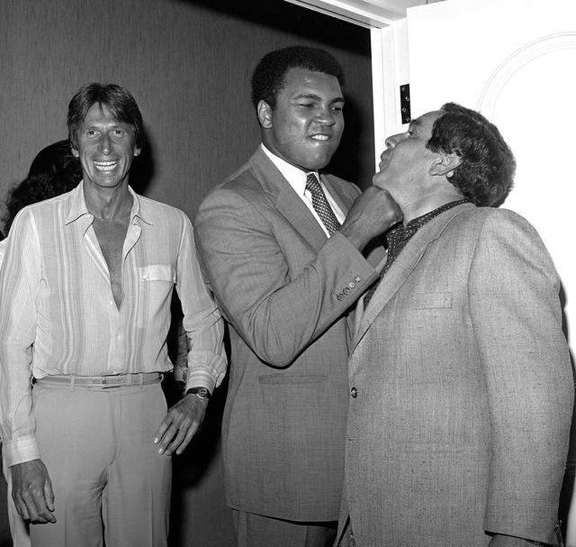 Muhammad Ali jokes with a guest as comedian David Brenner stands by at Caesars Palace Sept. 16, 1981. (Las Vegas News Bureau)