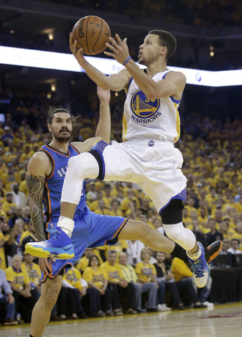 Golden State Warriors guard Stephen Curry (30) shoots against Oklahoma City Thunder center Steven Adams during the second half of Game 7 of the NBA basketball Western Conference finals in Oakland, ...