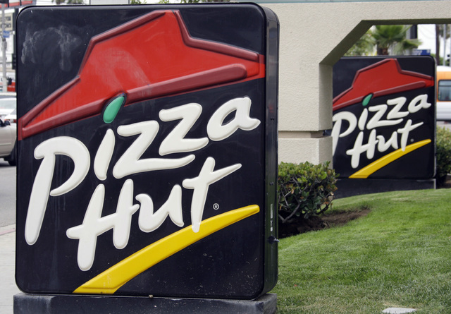 FILE - This Oct. 5, 2010 file photo shows the front of a  Pizza Hut restaurant in Los Angeles.   Pizza Hut says it will remove more artificial ingredients from its pizza pies in the next year. Piz ...