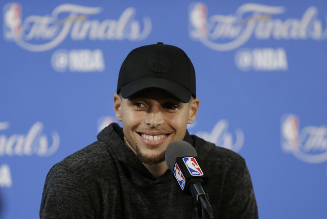 Golden State Warriors guard Stephen Curry smiles at a news conference after Game 2 of basketball's NBA Finals against the Cleveland Cavaliers in Oakland, Calif., Sunday, June 5, 2016. The Warriors ...