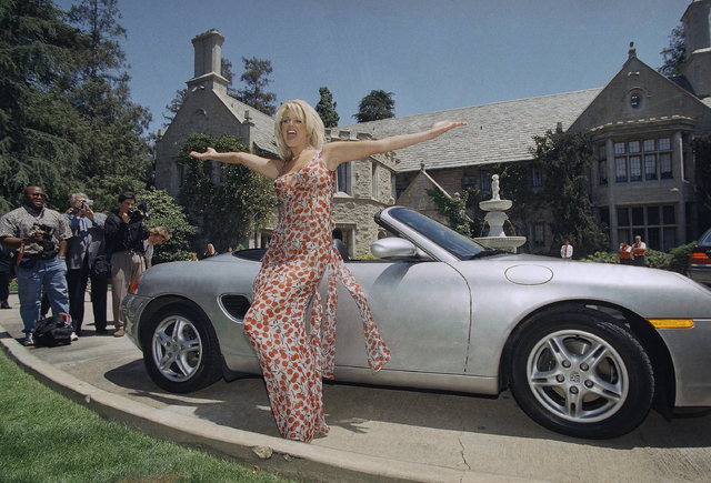 ictoria Silvstedt poses with her 1997 Porsche Boxter in front of the Playboy Mansion in Beverly Hills, Calif., before a lunch reception to announce her as the 1997 Playboy Playmate of the Year, Ma ...
