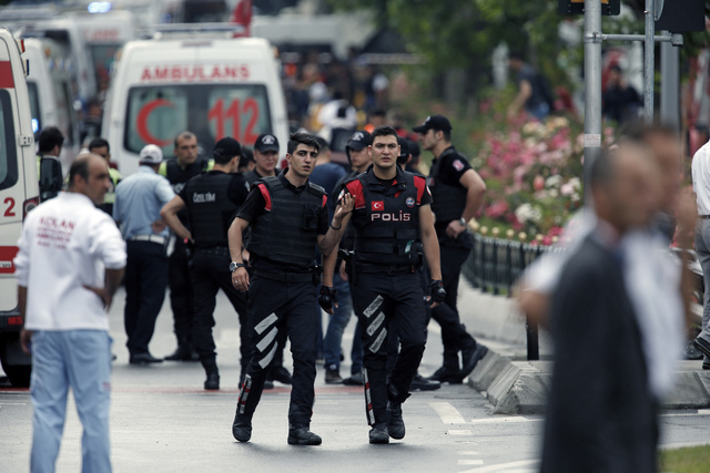 Turkish police and ambulances gather at the scene of a blast after an explosion in Istanbul, Tuesday, June 7, 2016. A car bomb attack targeting a bus carrying riot police during rush hour traffic  ...