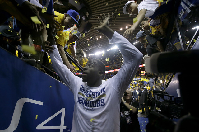 Golden State Warriors forward Draymond Green greets fans after the Warriors beat the Cleveland Cavaliers in Game 2 of basketball's NBA Finals in Oakland, Calif., Sunday, June 5, 2016. The Warriors ...