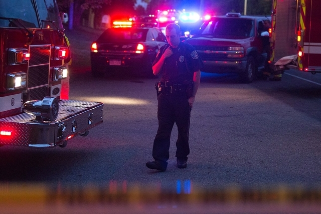 Kalamazoo Public Safety Officer Bryan Martin talks on the phone at the scene after multiple bicyclists were struck in a deadly crash Tuesday, June 7, 2016, in Cooper Township, Mich. (Bryan Bennett ...