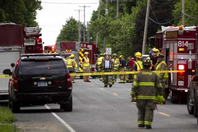 Police and rescue workers attend to the scene after multiple bicyclists were struck by a vehicle in a deadly crash Tuesday, June 7, 2016, in Copper Township, Mich. (Chelsea Purgahn/Kalamazoo Gazet ...