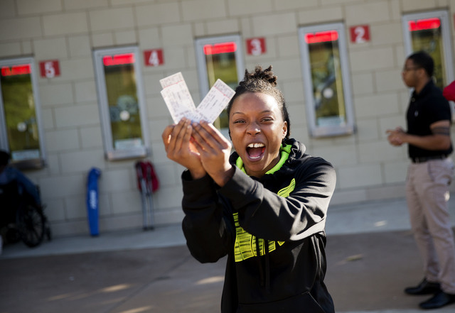 A woman cheers after receiving tickets to Muhammad Ali's memorial service Friday at the KFC Yum! Center Wednesday, June 8, 2016, in Louisville, Ky. Ali's memorial service Friday looms as one of th ...