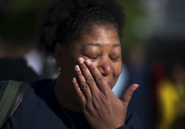 Felicia Garr, of Louisville, wipes a tear after receiving tickets to Muhammad Ali's memorial service Friday at the KFC Yum! Center Wednesday, June 8, 2016, in Louisville, Ky. (David Goldman/AP)