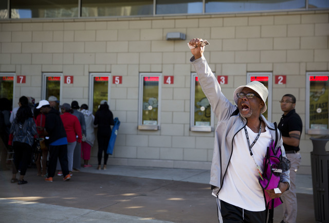 "Twyman Reed, of Louisville, chants ""They brought him home, they brought him home,"" after receiving his tickets to Muhammad Ali's memorial service Friday at the KFC Yum! Center Wednesday, June 8, 2 ..."