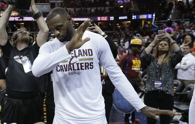 Cleveland Cavaliers' LeBron James celebrates the team's 120-90 win over the Golden State Warriors in Game 3 of basketball's NBA Finals in Cleveland, Wednesday, June 8, 2016. (Tony Dejak/AP)
