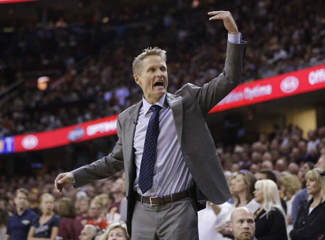 Golden State Warriors coach Steve Kerr gives directions to his team during the first half against the Cleveland Cavaliers in Game 3 of basketball's NBA Finals in Cleveland, Wednesday, June 8, 2016 ...