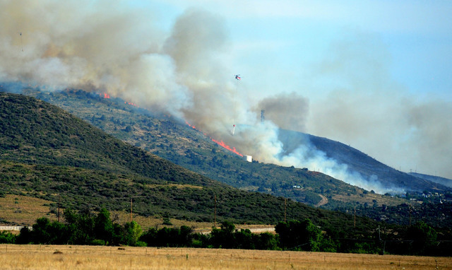 A brush fire burns in Yarnell, Ariz., Wednesday, June 8, 2016. The brush fire threatened structures in north-central Arizona, the scene of a 2013 wildfire in which 19 members of an elite firefight ...