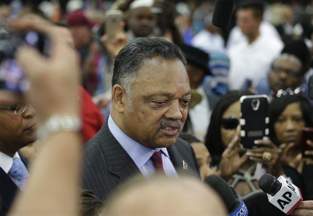 American civil rights activist Jesse Jackson speaks to members of the media before Muhammad Ali's Jenazah, a traditional Islamic Muslim service, in Freedom Hall, Thursday, June 9, 2016, in Louisvi ...