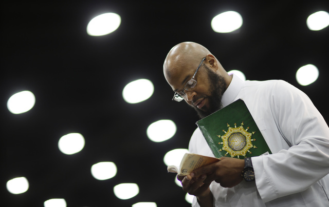 Saayfullaah Ali reads prayers before Muhammad Ali's Jenazah, a traditional Islamic Muslim service, in Freedom Hall, Thursday, June 9, 2016, in Louisville, Ky. (AP Photo/David Goldman)
