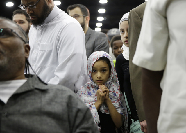 Eight-year-old Layla Selenica waits for Muhammad Ali's Jenazah, a traditional Islamic Muslim service, in Freedom Hall, Thursday, June 9, 2016, in Louisville, Ky. (David Goldman/AP)