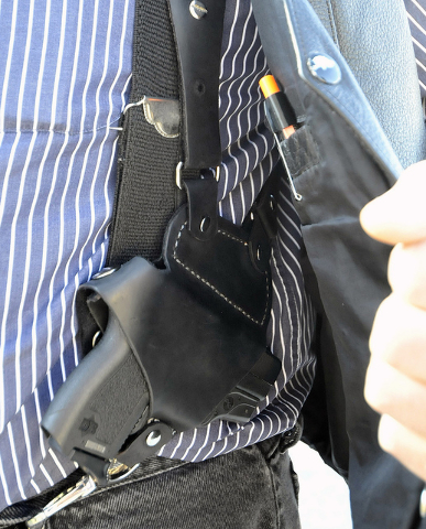 In this  file photo, a small handgun is seen under a vest in High Point, N.C. Dealing a blow to gun supporters, a federal appeals court ruled Thursday, June 9, 2016, that Americans do not have a c ...