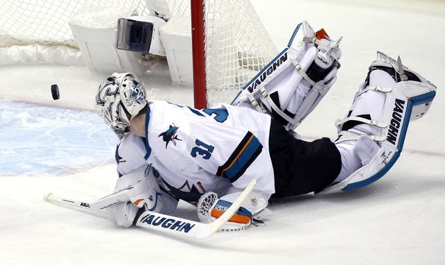 San Jose Sharks goalie Martin Jones watches the puck shot for a goal by Pittsburgh Penguins' Evgeni Malkin rattle out of the net during the first period in Game 5 of the NHL hockey Stanley Cup Fin ...