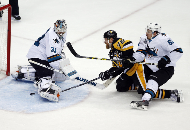 San Jose Sharks goalie Martin Jones (31) turns away a shot by Pittsburgh Penguins' Patric Hornqvist (72) as Sharks' Justin Braun (61) defends during the second period in Game 5 of the NHL hockey S ...