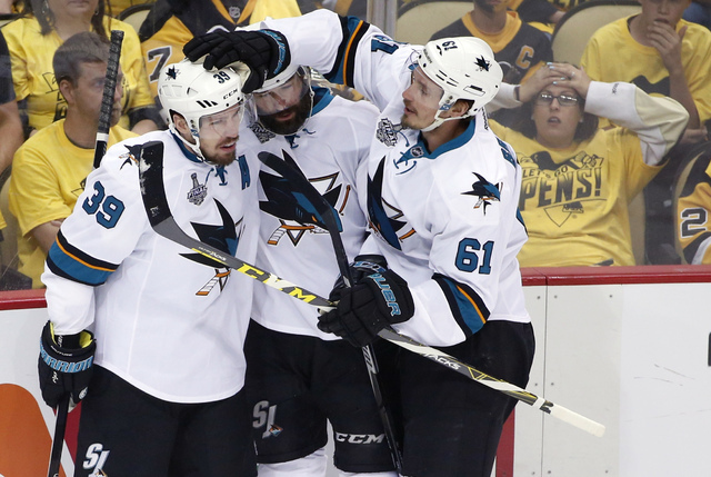 San Jose Sharks' Logan Couture (39) celebrates his goal against the Pittsburgh Penguins with teammates during the first period in Game 5 of the NHL hockey Stanley Cup Finals on Thursday, June 9, 2 ...