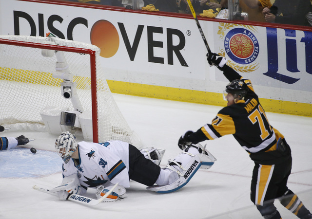Pittsburgh Penguins' Evgeni Malkin, right, celebrates his goal against San Jose Sharks goalie Martin Jones during the first period in Game 5 of the NHL hockey Stanley Cup Finals on Thursday, June  ...
