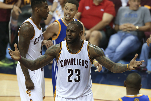 9a1c850216e Cleveland Cavaliers forward LeBron James (23) questions a call