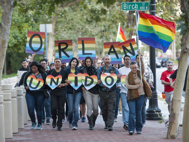 Several hundred supporters, led by Laura Kanter, at right, marched to Sasscer Park after a vigil at Calle Cuatro Plaza in support of the Orlando shooting victims Sunday, June 12, 2016, in Santa An ...
