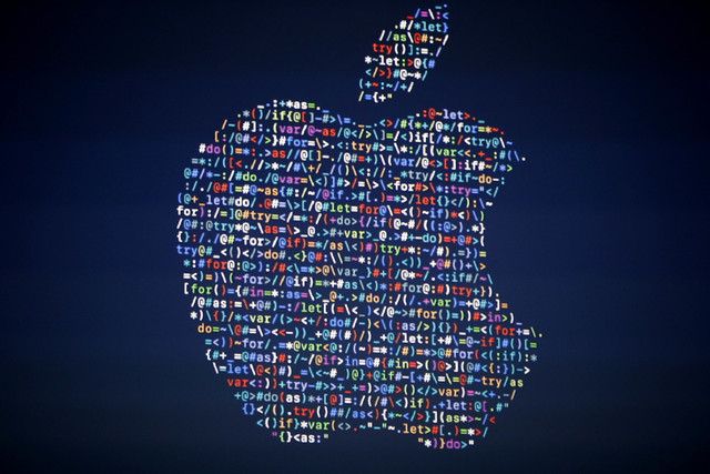 The Apple logo is shown on a screen at the Apple Worldwide Developers Conference in the Bill Graham Civic Auditorium in San Francisco on June 13, 2016. (Tony Avelar/AP)