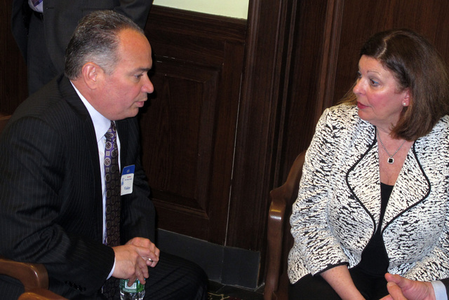 Mark Giannantonio, left, president of Resorts Casino Hotel, speaks with Debra DiLorenzo, right, president of a coalition formed to defeat a November ballot question that would authorize two new ca ...